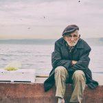 older man sitting on a dock
