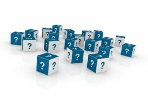 many blue and white cubes with question marks printed on them
