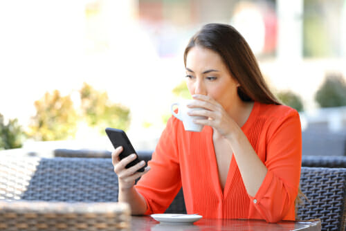 Woman checking text reminder